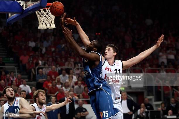 Derrick Allen of Frankfurt is challenged by Tibor Pleiss of Brose Baskets during game five of the Beko Basketball Bundesliga play off finals between...