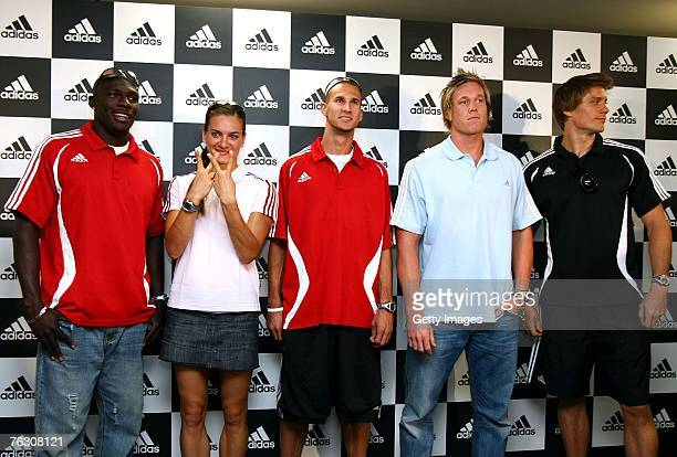 Derrick Atkins of the Bahamas Yelena Isinbayeva of Russia Jeremy Wariner and Breaux Greer of the United States of America stand with Andreas...