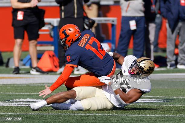 Derrick Barnes of the Purdue Boilermakers sacks Matt Robinson of the Illinois Fighting Illini in the first quarter at Memorial Stadium on October 31,...