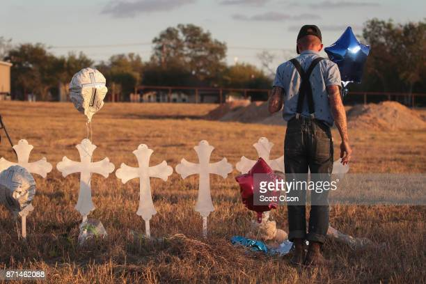Derrick Bernaden of San Antonio Texas visits a memorial where 26 crosses stand in a field on the edge of town to honor the 26 victims killed at the...