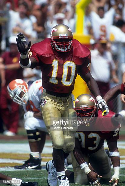 Derrick Brooks of the Florida State Seminoles celebrates on the field during an NCAA game against the Clemson Tigers on September 11 1993 at Doak...