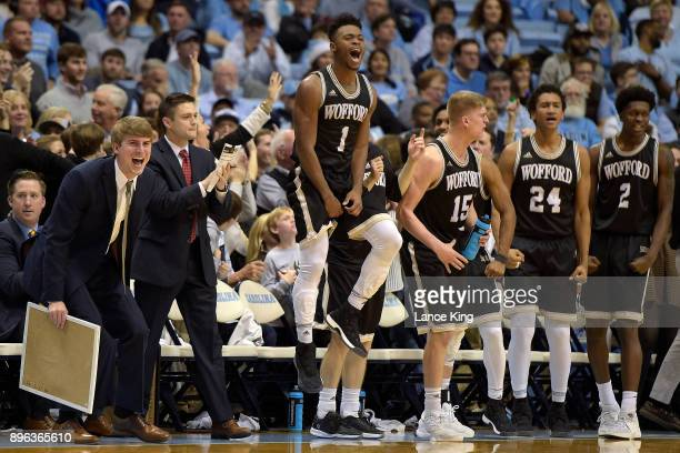 Derrick Brooks of the Wofford Terriers celebrates with teammates from their bench during their game against the North Carolina Tar Heels at Dean...
