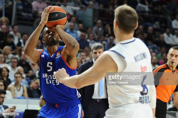 Derrick Brown #5 forward of Anadolu Efes and Andres 'Chapu' Nocioni #6 forward of Real Madrid during the 2016/2017 Turkish Airlines Euroleague...