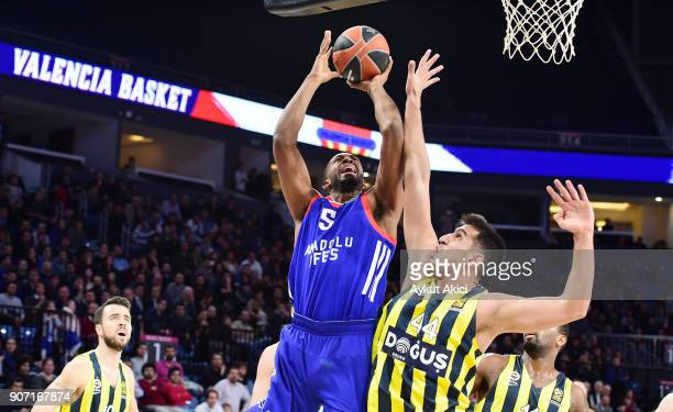 Derrick Brown #5 of Anadolu Efes Istanbul competes with Ahmet Duverioglu #44 of Fenerbahce Dogus Istanbul during the 2017/2018 Turkish Airlines...