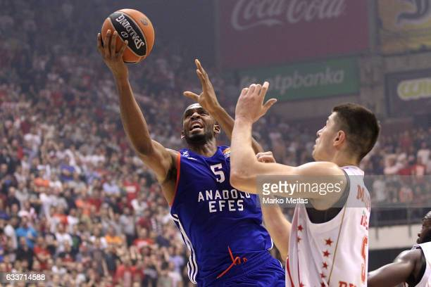 Derrick Brown #5 of Anadolu Efes Istanbul competes with Luka Mitrovic #9 of Crvena Zvezda mts Belgrade during the 2016/2017 Turkish Airlines...
