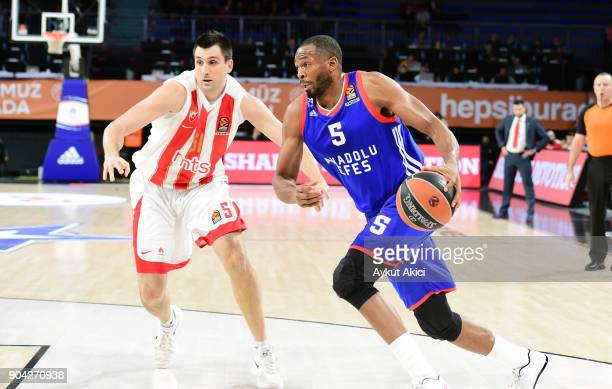 Derrick Brown #5 of Anadolu Efes Istanbul competes with Milko Bjelica #51 of Crvena Zvezda mts Belgrade during the 2017/2018 Turkish Airlines...