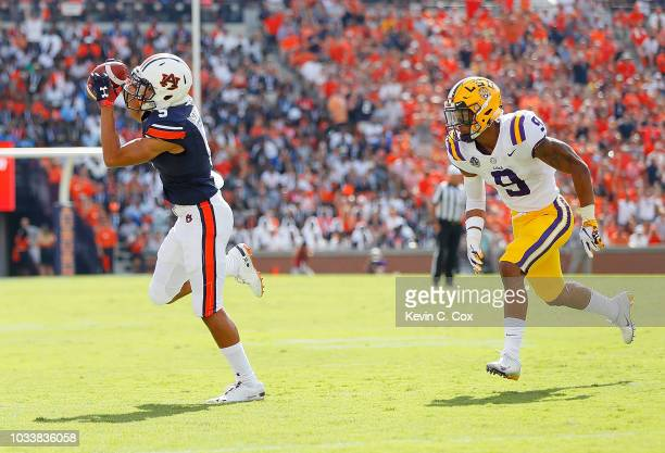 Derrick Brown of the Auburn Tigers pulls in this reception against Grant Delpit of the LSU Tigers at JordanHare Stadium on September 15 2018 in...