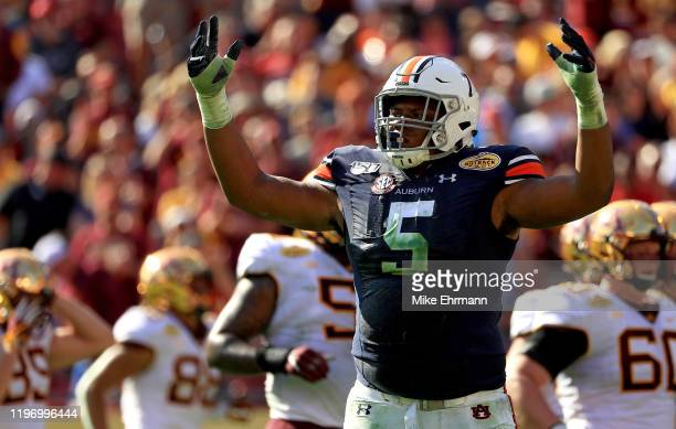 Derrick Brown of the Auburn Tigers reacts to a play during the 2020 Outback Bowl against the Minnesota Golden Gophers at Raymond James Stadium on...