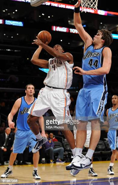 Derrick Brown of the Charlotte Bobcats puts a shot up against Kyrylo Fesenko of the Utah Jazz durng a preseason game at Staples Center on October 18...