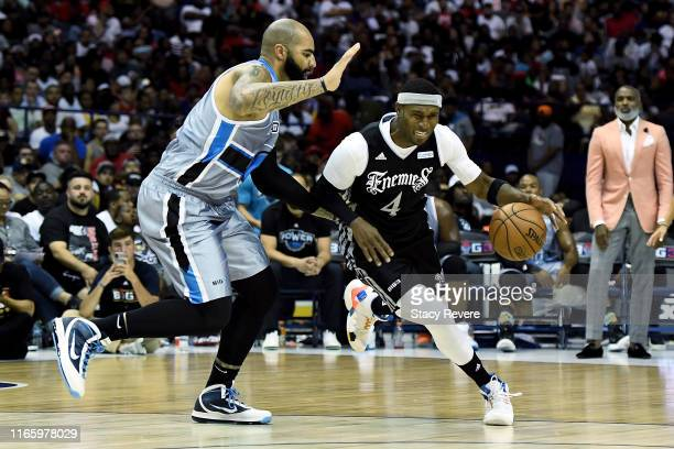 Derrick Byars of the Enemies dribbles the ball while being guarded by Carlos Boozer of the Power in the first half during week seven of the BIG3...