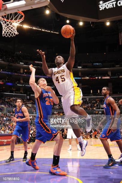 Derrick Caracter of the Los Angeles Lakers goes up for a shot against Timofey Mozgov of the New York Knicks at Staples Center on January 9 2011 in...