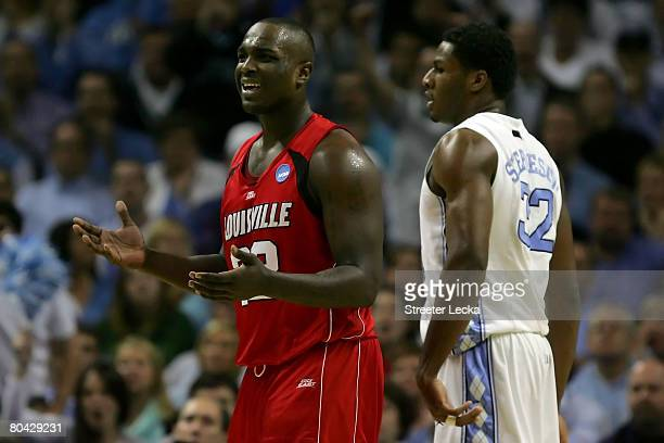 Derrick Caracter of the Louisville Cardinals reacts as he stands alongside Alex Stepheson of the North Carolina Tar Heels during the 2008 NCAA Men's...
