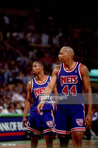 Derrick Coleman and Kenny Anderson of the New Jersey Nets wait to resume play against the Boston Celtics during a game played at the Boston Garden in...