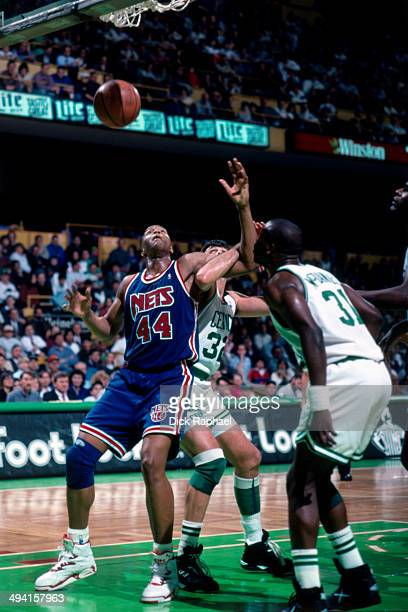 Derrick Coleman of the New Jersey Nets boxesout Kevin McHale of the Boston Celtics during a game played at the Boston Garden in Boston Massachusetts...