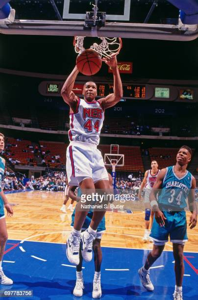 Derrick Coleman of the New Jersey Nets dunks against the Charlotte Hornets circa 1990 at the Brendan Byrne Arena in East Rutherford New Jersey NOTE...