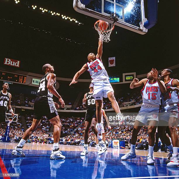 Derrick Coleman of the New Jersey Nets dunks against the San Antonio Spurs circa 1991 at the Brendan Byrne Arena in East Rutherford New Jersey NOTE...