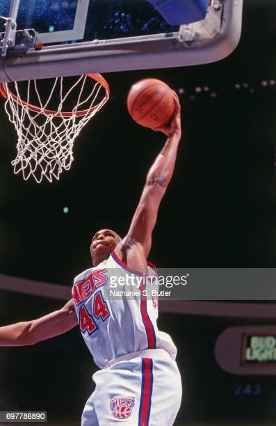 Derrick Coleman of the New Jersey Nets dunks circa 1990 at the Brendan Byrne Arena in East Rutherford New Jersey NOTE TO USER User expressly...