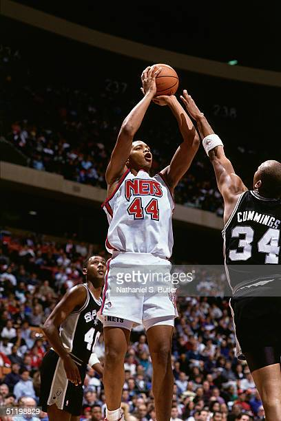 Derrick Coleman of the New Jersey Nets goes up for a jump shot over Terry Cummings of the San Antonio Spurs during an NBA game at the Brendan Byrne...