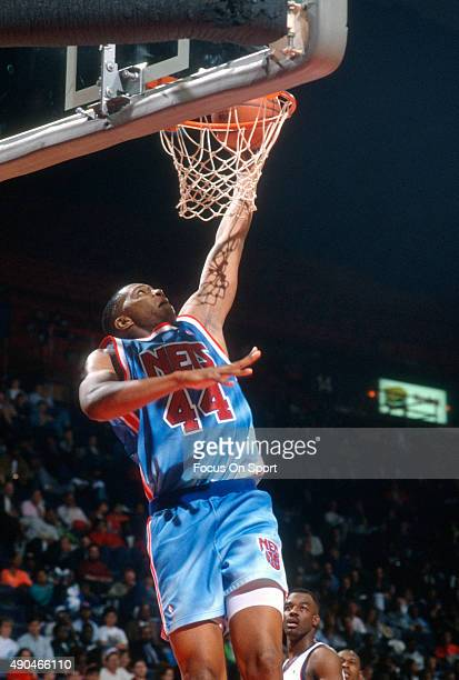Derrick Coleman of the New Jersey Nets goes up for a slam dunk against the Washington Bullets during an NBA basketball game circa 1991 at the Capital...