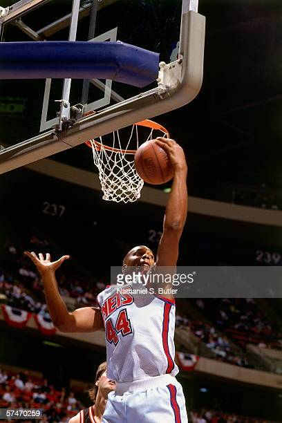 Derrick Coleman of the New Jersey Nets grabs a rebound during a game against the Miami Heat circa 1991 at the Brendan Byrne Arena in East Rutherford...