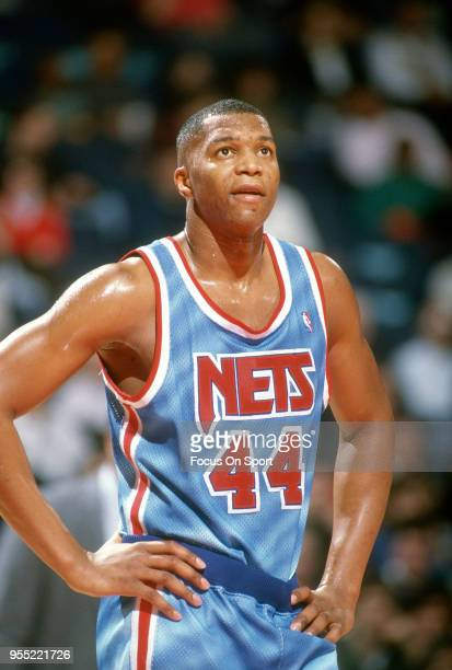 Derrick Coleman of the New Jersey Nets looks on against the Washington Bullets during an NBA basketball game circa 1991 at The Capital Centre in...