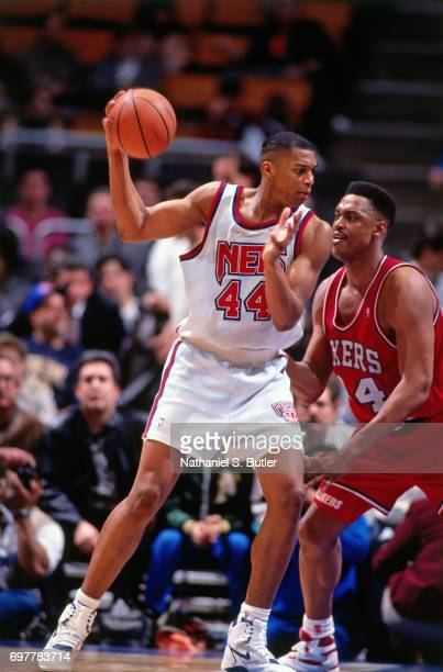 Derrick Coleman of the New Jersey Nets looks to drive against the Philadelphia 76ers circa 1990 at the Brendan Byrne Arena in East Rutherford New...