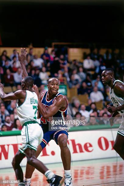 Derrick Coleman of the New Jersey Nets looks to drive to the basket against Dee Brown of the Boston Celtics during a game played circa 1994 at the...