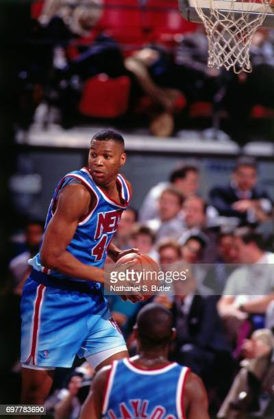 Derrick Coleman of the New Jersey Nets looks to passcirca 1990 at the Brendan Byrne Arena in East Rutherford New Jersey NOTE TO USER User expressly...