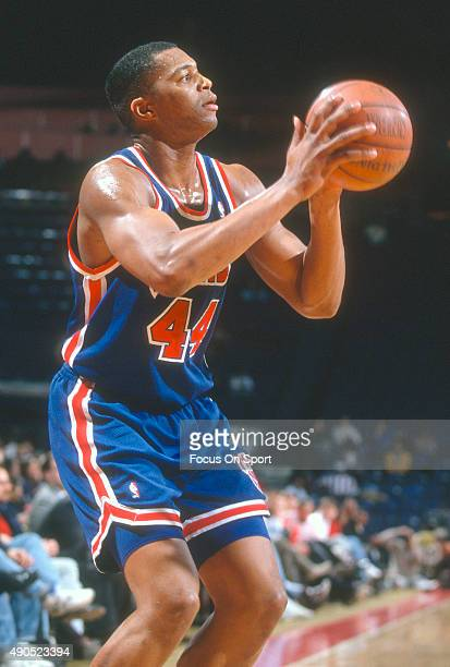 Derrick Coleman of the New Jersey Nets looks to shoot against the Philadelphia 76ers during an NBA basketball game circa 1992 at The Spectrum in...