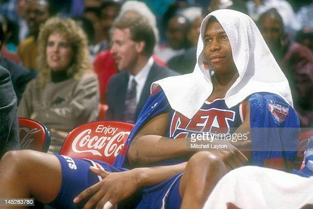 Derrick Coleman of the New Jersey Nets on the bench during a basketball game against the Washington Bullets at the Capitol Centre on March 25 1991 in...
