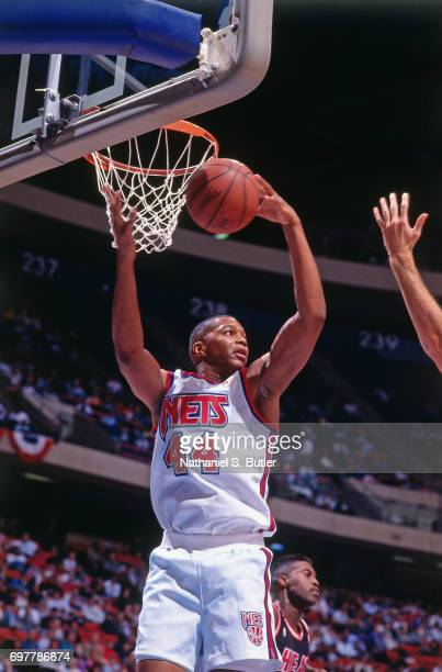Derrick Coleman of the New Jersey Nets rebounds circa 1990 at the Brendan Byrne Arena in East Rutherford New Jersey NOTE TO USER User expressly...