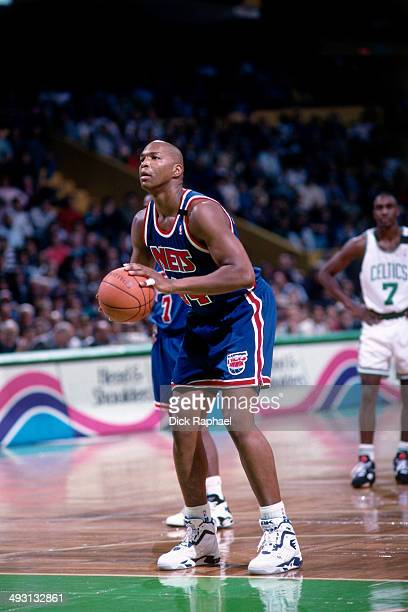 Derrick Coleman of the New Jersey Nets shoots a free throw against the Boston Celtics during a game played circa 1994 at the Boston Garden in Boston...