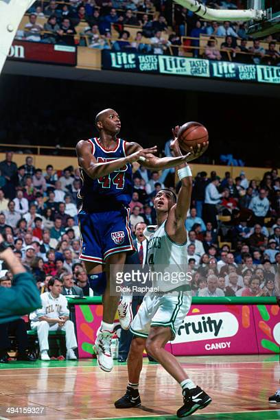Derrick Coleman of the New Jersey Nets shoots a layup against Alaa Abdelnaby of the Boston Celtics during a game played at the Boston Garden in...