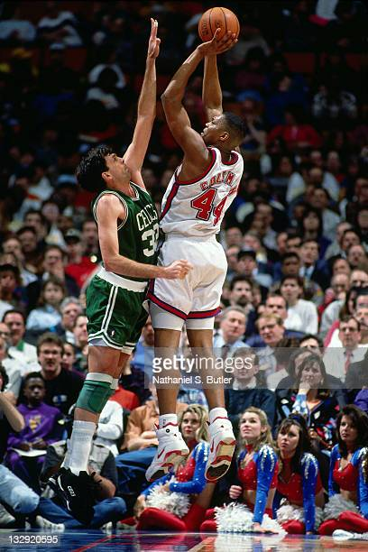 Derrick Coleman of the New Jersey Nets shoots against Kevin McHale of the Boston Celtics circa 1991 at the Brendan Byrne Arena in East Rutherford New...
