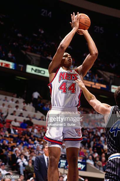 Derrick Coleman of the New Jersey Nets shoots against the Orlando Magic circa 1991 at Madison Square Garden in New York NOTE TO USER User expressly...