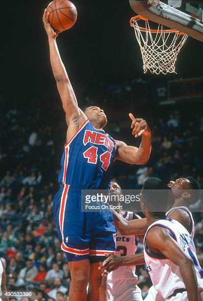 Derrick Coleman of the New Jersey Nets shoots against the Washington Bullets during an NBA basketball game circa 1992 at the Capital Centre in...