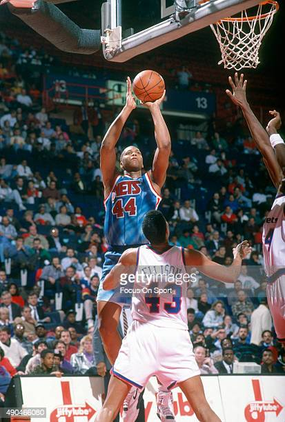 Derrick Coleman of the New Jersey Nets shoots over Ellison of the Washington Bullets during an NBA basketball game circa 1991 at the Capital Centre...