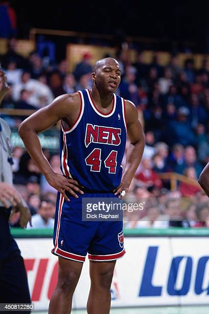 Derrick Coleman of the New Jersey Nets stands on the court during a game against the Boston Celtics circa 1995 at the Boston Garden in Boston...