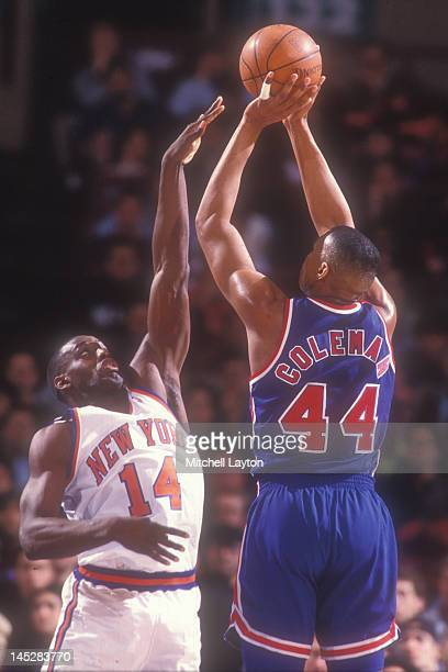 Derrick Coleman of the New Jersey Nets takes a shot over Anthony Mason of the New York Knicks during a basketball game Madison Square Garden on March...