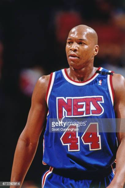 Derrick Coleman of the New Jersey Nets walks against the Atlanta Hawks during a game played circa 1990 at the Omni in Atlanta Georgia NOTE TO USER...