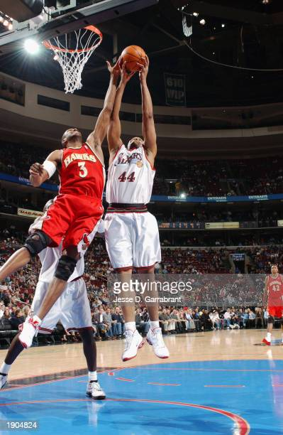 Derrick Coleman of the Philadelphia 76ers battles for a rebound against Shareef Abdur-Rahim of the Atlanta Hawks during the NBA game at First Union...