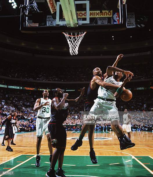 Derrick Coleman of the Philadelphia 76ers blocks a shot by Paul Pierce of the Boston Celtics during game 5 of the Eastern Conference quarterfinals...