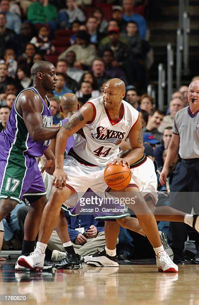 Derrick Coleman of the Philadelphia 76ers dribbles against Anthony Mason of the Milwaukee Bucks during the game at First Union Center on January 17,...