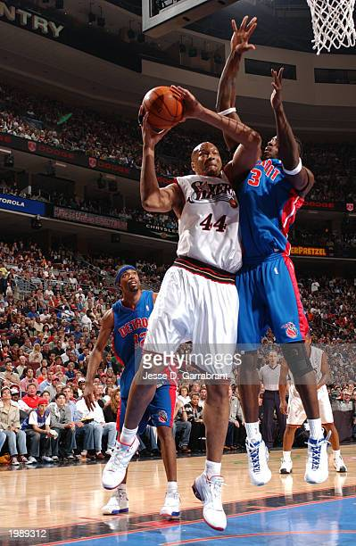Derrick Coleman of the Philadelphia 76ers drives against Ben Wallace of the Detroit Pistons in Game 3 of the Eastern Conference Semifinals of the...