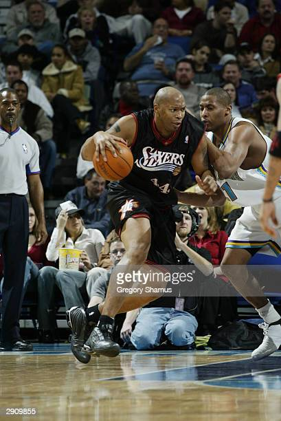 Derrick Coleman of the Philadelphia 76ers drives on Jamaal Magloire of the New Orleans Hornets during the game at the New Orleans Arena on January 21...