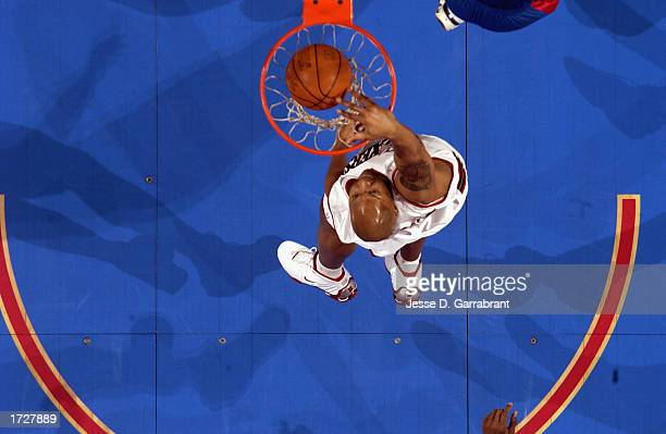 Derrick Coleman of the Philadelphia 76ers dunks during the NBA game against the Detroit Pistons at First Union Center on January 8 2003 in...