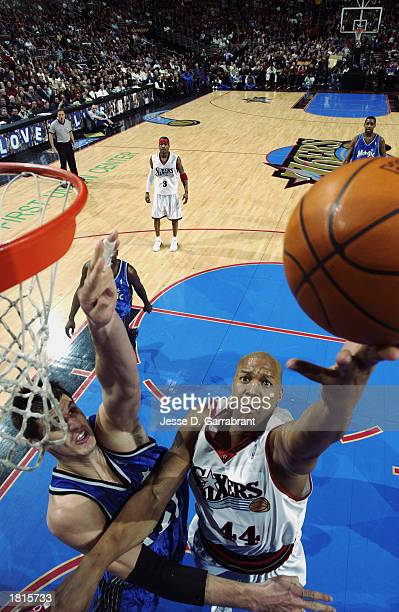 Derrick Coleman of the Philadelphia 76ers goes to the hoop against the Orlando Magic during the game at First Union Center on February 14 2003 in...