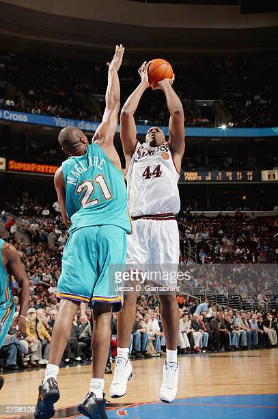Derrick Coleman of the Philadelphia 76ers goes up for a shot over Jamal Magloire of the New Orleans Hornets during a game at Wachovia Center on...