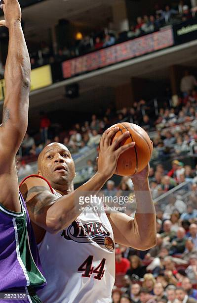 Derrick Coleman of the Philadelphia 76ers holds the ball against the Milwaukee Bucks during the game at Wachovia Center on January 5 2004 in...