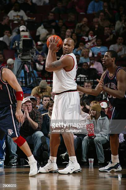 Derrick Coleman of the Philadelphia 76ers is defended by Jason Collins of the New Jersey Nets during the game at Wachovia Center on January 9, 2004...